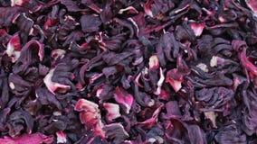 El hibisco seco florece el fondo de la textura de la rotaci?n del t? de la rosa sudanesa, karkade almacen de video