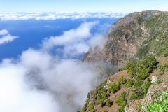 El Hierro - Passat clouds at the rock face of the El Golfo Valley royalty free stock photo