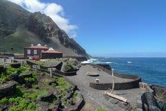El Hierro - Pozo de la Salud. Look over the viewing platform and the cliff coast in Pozo de la Salud, El Hierro, Canary Islands, Spain. The two buildings are royalty free stock image