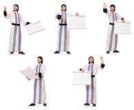 El hombre árabe con el Libro Blanco aislado en blanco fotografía de archivo