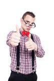 El hombre acertado del empollón manosea con los dedos para arriba Imagenes de archivo