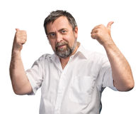 El hombre acertado muestra los pulgares para arriba Imágenes de archivo libres de regalías