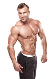 El hombre atlético fuerte muestra el cuerpo y los músculos abdominales Imagen de archivo