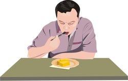 El hombre cena. Imagen de archivo