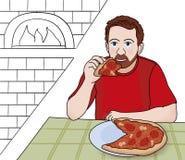 El hombre come la pizza Fotos de archivo