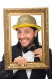 El hombre con el sombrero de oro aislado en blanco Imagen de archivo