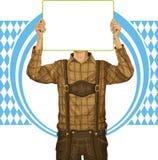 El hombre con escribe al tablero en Oktoberfest Imágenes de archivo libres de regalías