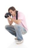 El hombre con la cámara aislada en un blanco Fotografía de archivo