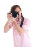 El hombre con la cámara aislada en un blanco Fotos de archivo libres de regalías