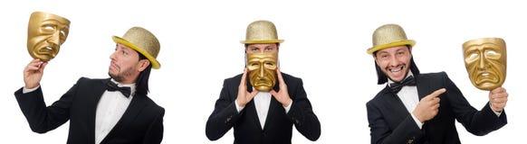 El hombre con la máscara del teatro aislada en blanco imagenes de archivo