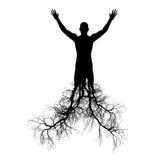 El hombre con las raíces del árbol Imagen de archivo libre de regalías