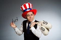 El hombre con los sacos del dinero del dólar Imagen de archivo