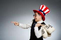 El hombre con los sacos del dinero del dólar Foto de archivo
