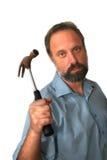 El hombre con un martillo. Foto de archivo libre de regalías