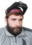 El hombre con una barba en magnificar señala Fotos de archivo libres de regalías