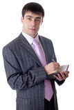 El hombre con una pluma de bola y a los cuadernos en manos Foto de archivo libre de regalías