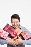El hombre da muchos regalos Imágenes de archivo libres de regalías