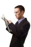 El hombre dado una sacudida eléctrica leyó el periódico Fotografía de archivo libre de regalías