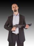 El hombre de la mafia está sosteniendo una escopeta Imagen de archivo libre de regalías