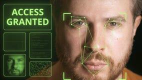 El hombre de los an?lisis del sistema del ordenador hace frente e identifica a la persona Acceso concedido almacen de metraje de vídeo