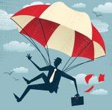 El hombre de negocios abstracto utiliza su paracaídas. Imágenes de archivo libres de regalías