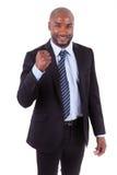 El hombre de negocios afroamericano negro apretó el puño - peop africano Imagenes de archivo