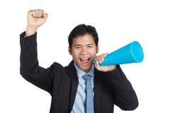 El hombre de negocios asiático anima para arriba con el megáfono Imagen de archivo