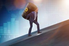 El hombre de negocios bajo carga del barril de aceite Imagen de archivo libre de regalías