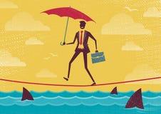 El hombre de negocios camina cuerda tirante con el paraguas Imágenes de archivo libres de regalías