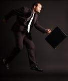 El hombre de negocios competitivo salta Imagen de archivo
