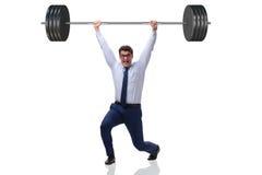 El hombre de negocios con el barbell en concepto de elevación pesado foto de archivo