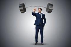 El hombre de negocios con el barbell en concepto de elevación pesado fotografía de archivo libre de regalías