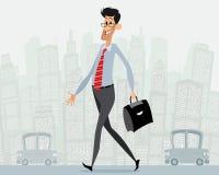El hombre de negocios con la cartera va Imagen de archivo