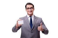 El hombre de negocios con la tarjeta en blanco aislada en el fondo blanco Fotos de archivo