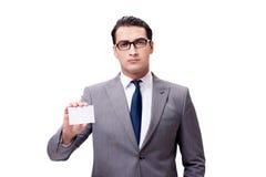 El hombre de negocios con la tarjeta en blanco aislada en el fondo blanco Imagenes de archivo