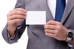 El hombre de negocios con la tarjeta en blanco aislada en el fondo blanco Imágenes de archivo libres de regalías