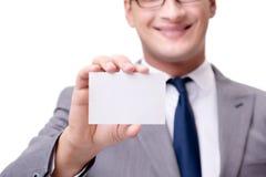 El hombre de negocios con la tarjeta en blanco aislada en el fondo blanco Fotografía de archivo libre de regalías