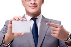 El hombre de negocios con la tarjeta en blanco aislada en el fondo blanco Imagen de archivo libre de regalías
