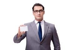 El hombre de negocios con la tarjeta en blanco aislada en el fondo blanco Foto de archivo libre de regalías