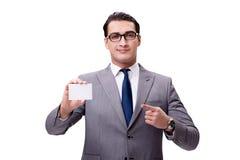 El hombre de negocios con la tarjeta en blanco aislada en el fondo blanco Fotos de archivo libres de regalías