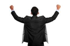 El hombre de negocios con los brazos aumentó en el éxito - aislado en blanco foto de archivo libre de regalías