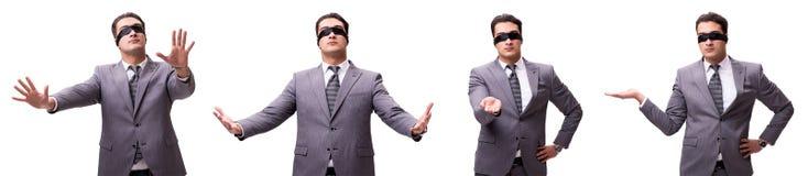 El hombre de negocios con los ojos vendados aislado en blanco imagenes de archivo