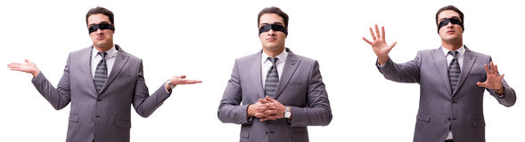 El hombre de negocios con los ojos vendados aislado en blanco imágenes de archivo libres de regalías