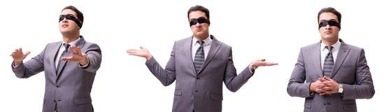 El hombre de negocios con los ojos vendados aislado en blanco foto de archivo
