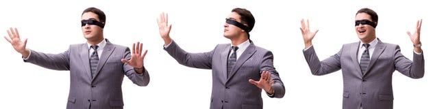 El hombre de negocios con los ojos vendados aislado en blanco fotografía de archivo libre de regalías
