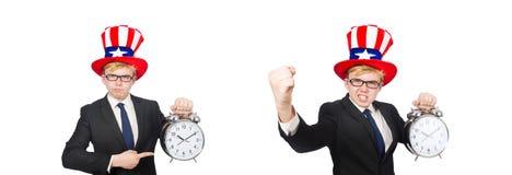 El hombre de negocios con el reloj aislado en blanco imagenes de archivo