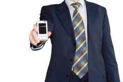 El hombre de negocios da el móvil foto de archivo
