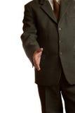 El hombre de negocios da una mano Foto de archivo libre de regalías
