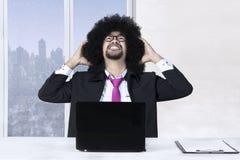 El hombre de negocios del Afro tiene problema Foto de archivo libre de regalías