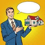 El hombre de negocios del agente inmobiliario ofrece a casa